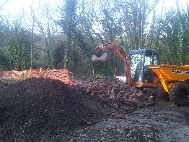 Moving spoil heaps.
